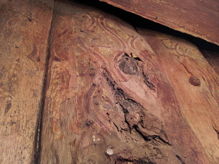 Victorian era wall paper fragments on split iron bark slabs eerily redolent of western desert painting